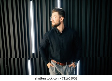Portrait of Young businessman standing in office lobby