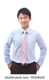 portrait of a young businessman standing with smile isolated on white background, model is a asian