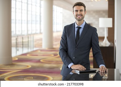 Portrait of young businessman staring at the camera in a hotel lobby