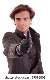 Portrait of a young businessman with thumb up, in autumn/winter clothes, isolated on white. Studio shot