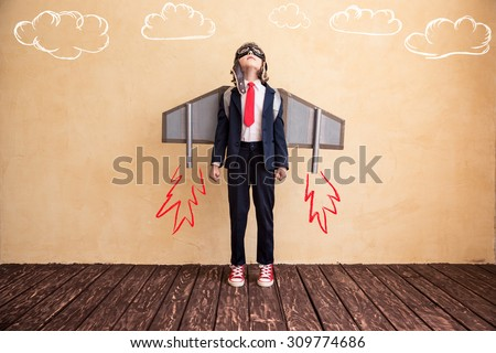 Portrait of young businessman with toy paper wings. Success, creative and start up concept. Copy space for your text