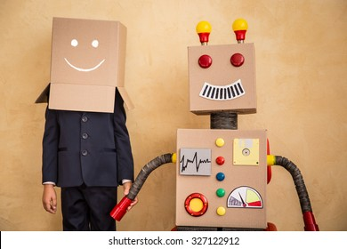 Portrait of young businessman with toy robot in modern loft office. Success, creative and innovation technology concept. Copy space for your text