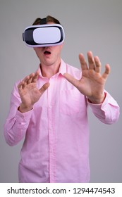 Portrait of young businessman using virtual reality headset