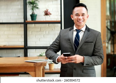 portrait of young businessman waiting for meeting appointment at cafe