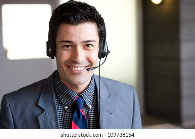 portrait of a young businessman wearing headset