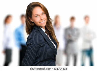 Portrait of a young businesswoman in front of her team