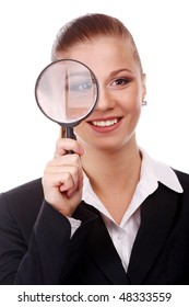 portrait of young businesswoman with magnifying glass