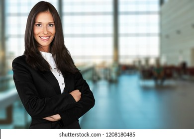 Portrait of a young  businesswoman  on background