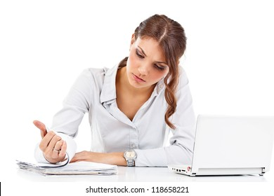 Portrait of young businesswoman reading the documents