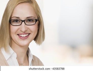 portrait of young businesswoman, smiling, close up