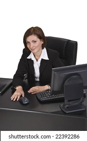 Portrait of a young businesswoman at ther desk in the office.