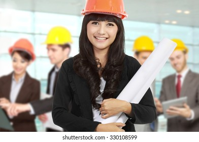 A portrait of a young businesswoman wear a safety helmet