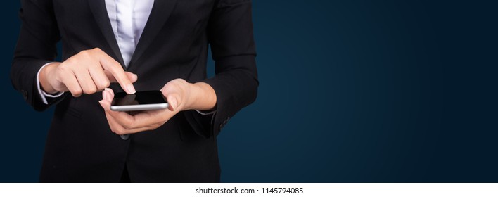 Portrait young businesswomen in black suit using smartphone, pretty hipster manager holding mobile gadget, girl smiletexting message, connect