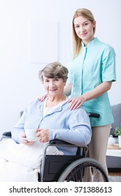 Portrait of young caregiver and senior woman