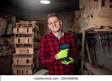 Portrait of young carpenter with drill