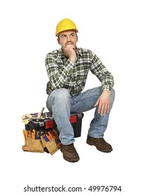 portrait of young  carpenter sit on his toolbox