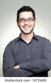 Portrait of young casual man with glasses smiling