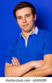 portrait of young casual man, on a blue background