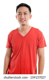 Portrait of young casual Southeast Asian man isolated over white background