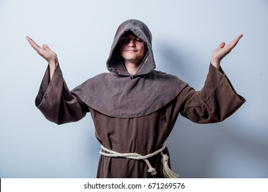 Portrait of Young catholic monk on white background