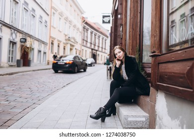 Portrait of young caucasian blondie pretty cute girl walking along the european streets. Old historical town, beauty girl concept