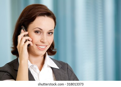 Portrait of young caucasian businesswoman talking on cellphone