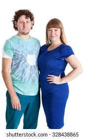 Portrait of young Caucasian couple standing together and looking at camera, isolated on black background