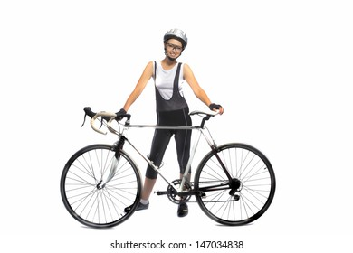 portrait of young caucasian sportswoman professionally equipped standing with bicycle isolated over white. horizontal shot