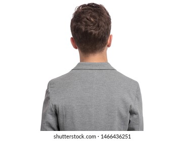 Portrait of young caucasian teen boy - rear view, isolated on white background. Funny teenager - back view. Handsome child in gray suit.