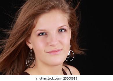 portrait of a young caucasian woman, black background