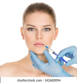 Portrait of young Caucasian woman getting cosmetic injection of botox, isolated over white background.