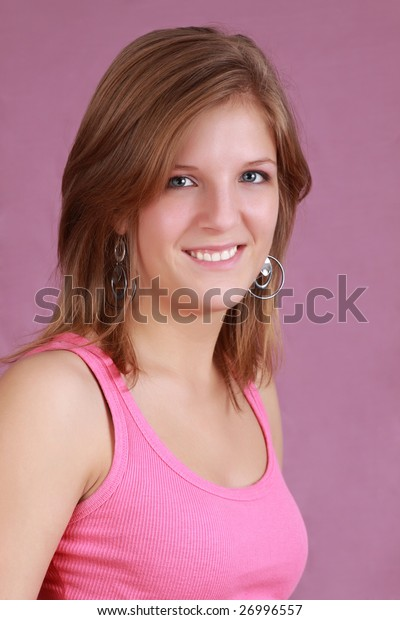 portrait of a young caucasian woman, pink background