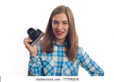 Portrait of young charming positive woman photographer with camera in casual clothes on white background