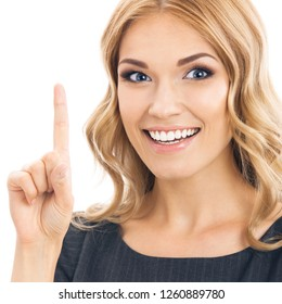 Portrait of young cheerful smiling thinking business woman, showing one finger or idea gesture, isolated over white background
