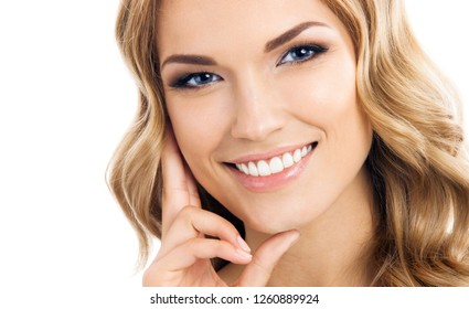 Portrait of young cheerful smiling thinking woman, isolated over white background