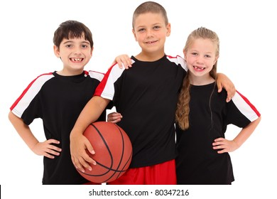 Portrait young child boy girl basketball team together smiling.