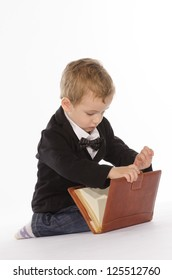 Portrait of young child with an notebook against white background