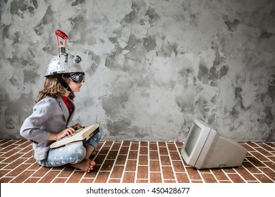 Portrait of young child pretend to be businessman. Nerd kid with toy virtual reality headset. Child geek playing at home. Kid having fun indoors. Success, creative and innovation technology concept