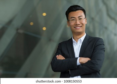 portrait of young Chinese businessman looking at camera smile