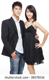 Portrait of young, Chinese working couple dressed up for date and party. Shot in studio isolated on white