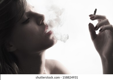 Portrait of young with cigarette
