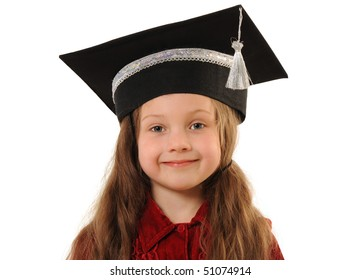 Portrait of young clever girl in grad cap