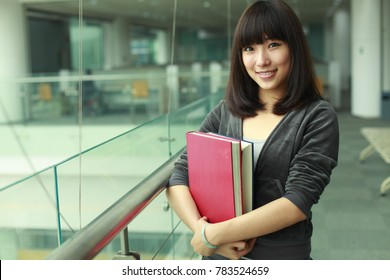 portrait of young college student in the library