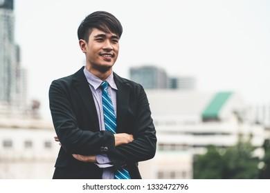 Portrait of young confident Asian businessman. Business concept.