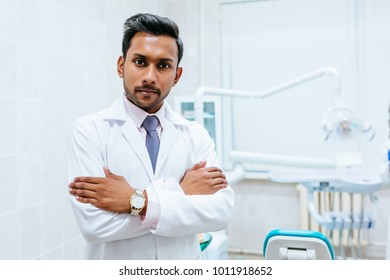 Portrait of a young confident asian male dentist in clinic. Dental clinic concept