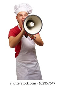 portrait of a young cook man screaming with a megaphone over a white background