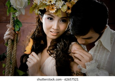 Portrait of young couple in antique dress in erotic emotion
