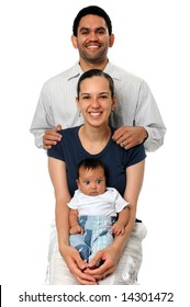 Portrait of young couple with baby isolated over a white background