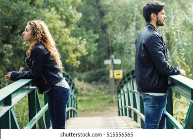 Portrait of young couple being in a conflict in the park.