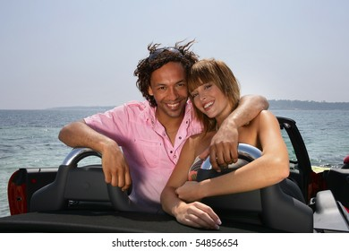 Portrait of a young couple in a car